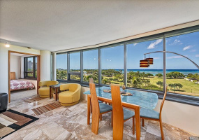 Panoramic view of iconic Ala Moana Regional Park and Pacific Ocean from the living room. Front row views of Magic Island!
